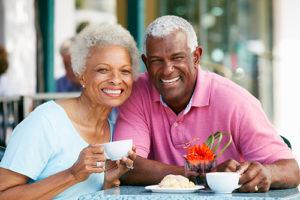 senior couple at a cafe near florida Senior Living Programs
