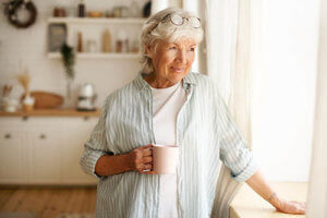 a woman reflects on her senior living amenities in salisbury