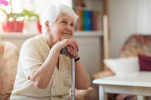 a woman is happy to be in a memory care nursing home in MD