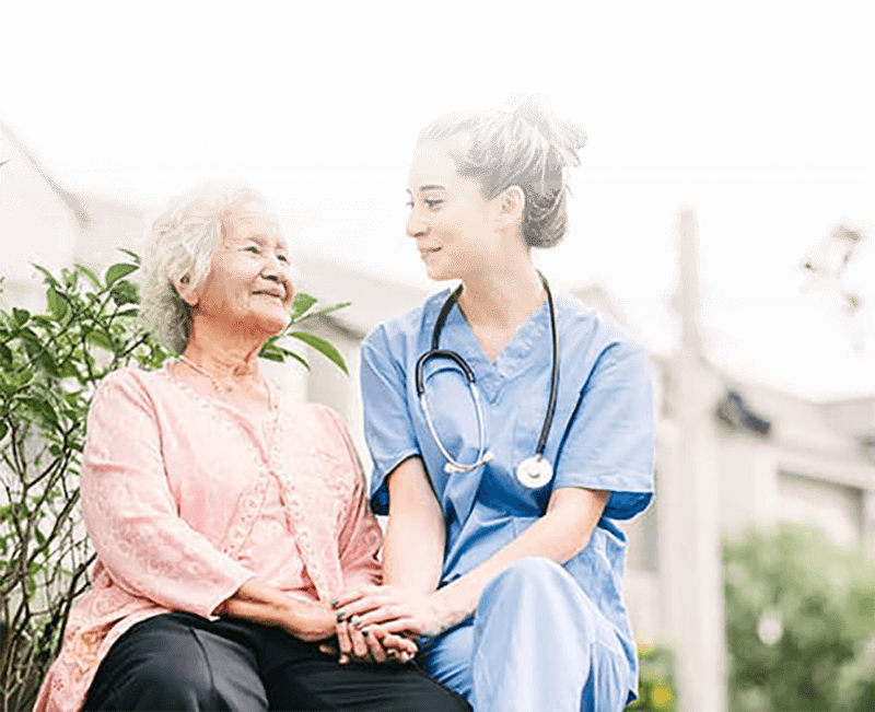 woman in memory care with nurse